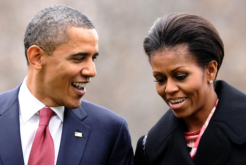 President Barack Obama and First Lady Michelle Obama chat as they walk to the White House in Washington, DC.