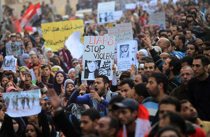 Egyptians gather for a protest in downtown Cairo to denounce the military's attacks on women and to call for an immediate end to the violence against protesters on December 20, 2011.