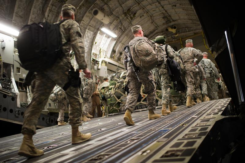 US soldiers board the last C17 aircraft carrying US troops out of Iraq.