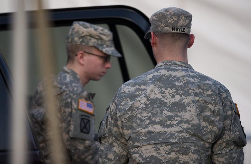 US Army Private First Class Bradley Manning (L), surrounded by US military, arrives at a US military Magistrate Court facility during an Article 32 hearing at Fort Meade, Maryland on December 19, 2011