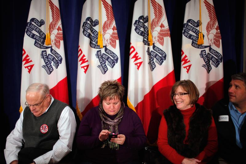 Supporters wait for the arrival of former Massachusetts Governor and Republican presidential candidate Mitt Romney for a rally at the Hotel Blackhawk December 27, 2011 in Davenport, Iowa.