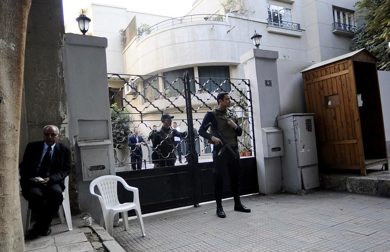 Egyptian soldiers stand guard in front of the US National Democratic Institute, an NGO rights group in downtown Cairo on December 29, 2011.
