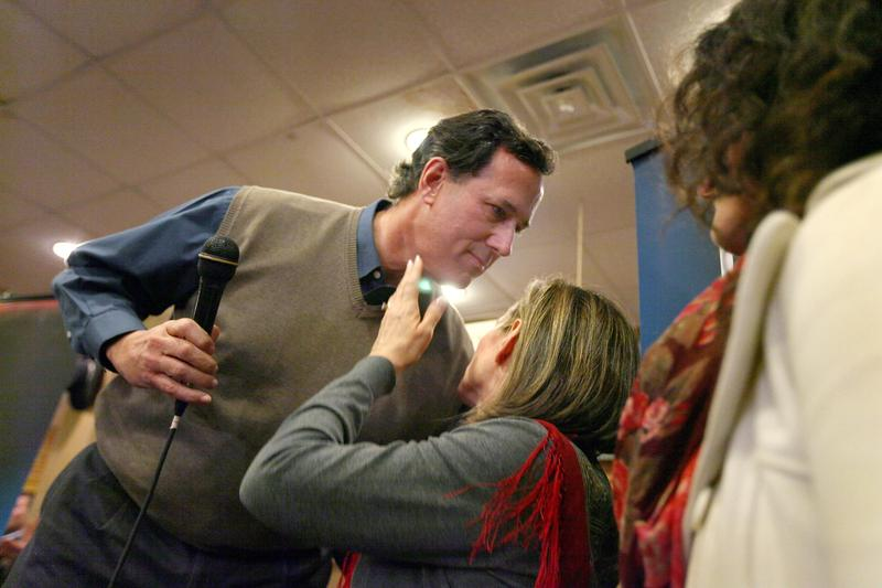 Republican presidential candidate former U.S. Senator Rick Santorum (R-PA) kisses his wife after fielding a question about the death of their son during a campaign rally in Newton, Iowa.