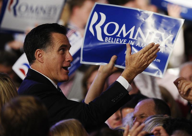 Mitt Romney greets supporters after addressing a primary night victory rally in Manchester, New Hampshire.