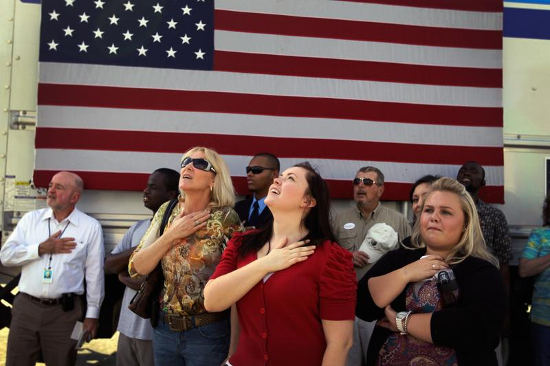 People recite the Pledge of Allegiance before Republican presidential candidate Newt Gingrich speaks during an event at the The River Church on January 23, 2012 in Tampa.