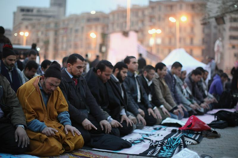 Members of the Muslim Brotherhood hold prayers in Tahir Square ahead of the first anniversary of the revolution on January 24, 2012 in Cairo, Egypt.