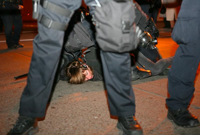 A protester from Occupy Oakland -the local offshoot of Occupy Wall Street- is arrested in Oakland on January 28, 2012.