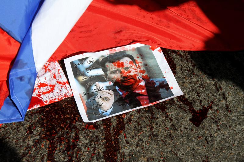 A photo of Syria's embattled President Bashar al-Assad lies on the ground next during a demonstration outside the Russian embassy in Beirut.