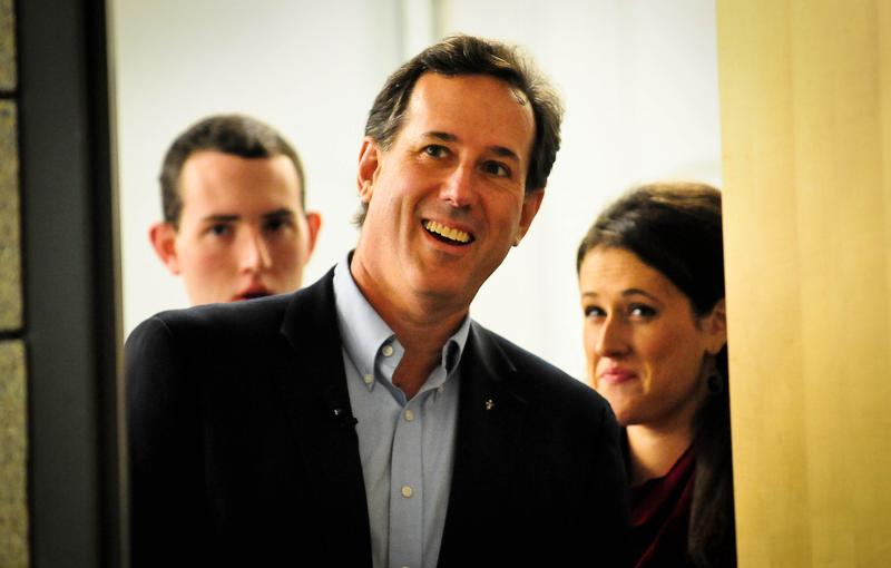 Rick Santorum waits backstage before a rally February in Blaine, Minnesota.