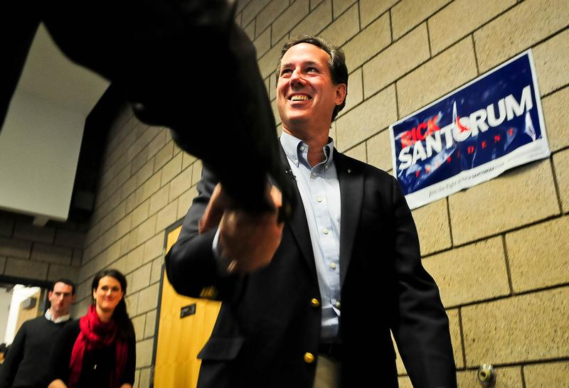 Republican presidential candidate, former U.S. Sen. Rick Santorum autographs a sign after speaking at a campaign rally February 7, 2012 in Blaine, Minnesota.