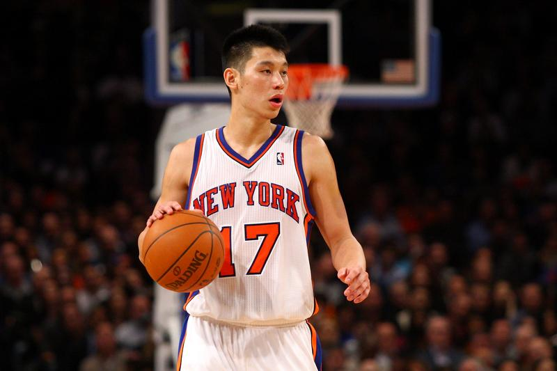 Jeremy Lin of the New York Knicks brings the ball up court against the Los Angeles Lakers.