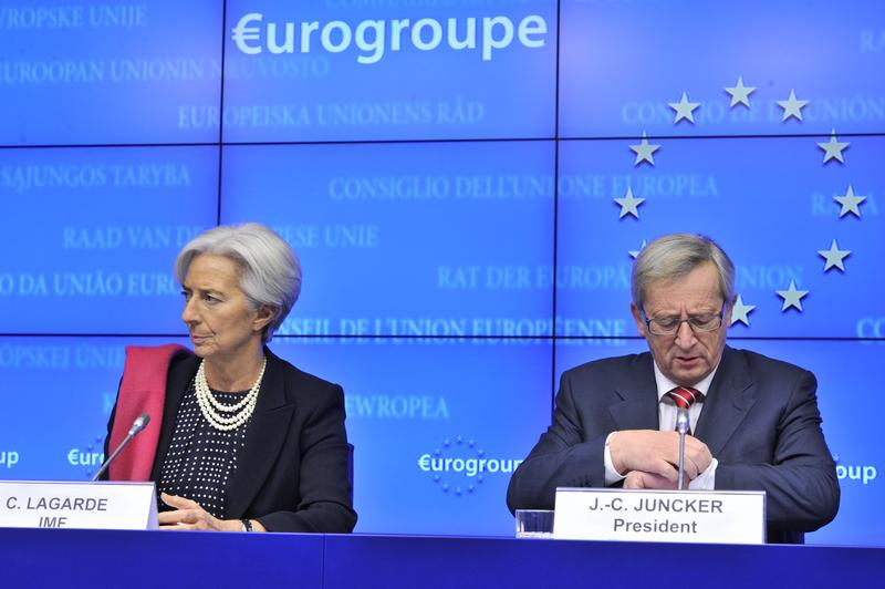 International Monetary Fund Managing Director Christine Lagarde (L) and Eurogroup president Jean-Claude Juncker give a press conference following an Eurozone meeting on February 21, 2012.