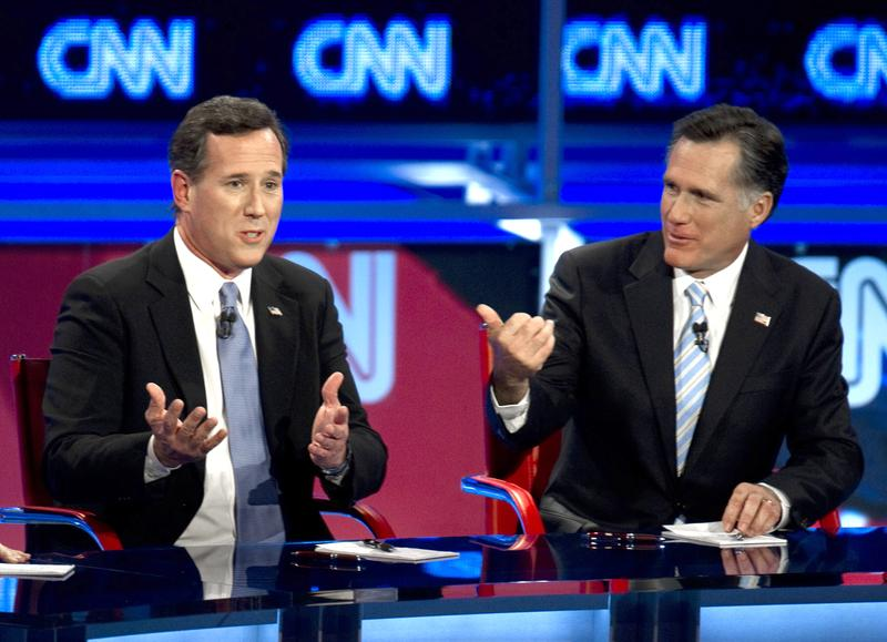 Rick Santorum and Mitt Romney debate on February 22, 2012 in Mesa, Arizona.