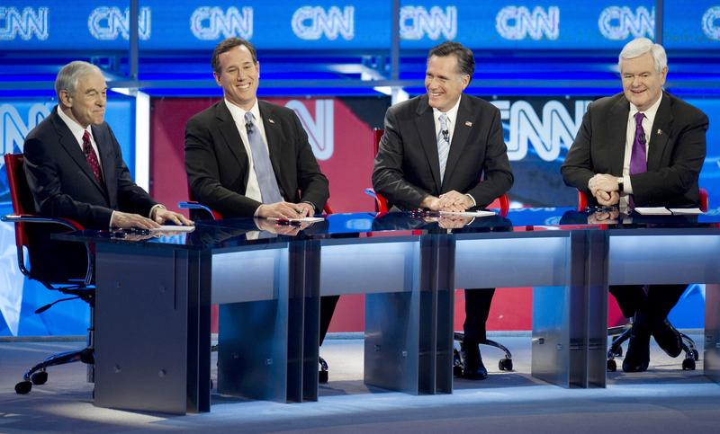 Republican presidential candidates Ron Paul (L), Rick Santorum (2nd L), Mitt Romney (2nd R) and Newt Gingrich during their debate on February 22, 2012 in Mesa, Arizona.