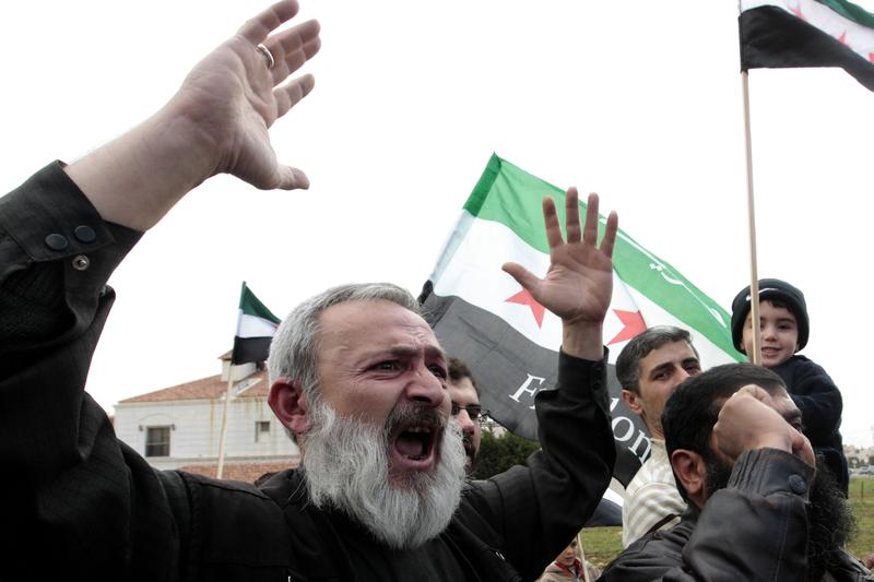 Syrians rally outside the US Embassy in Amman to demand a US military intervention.