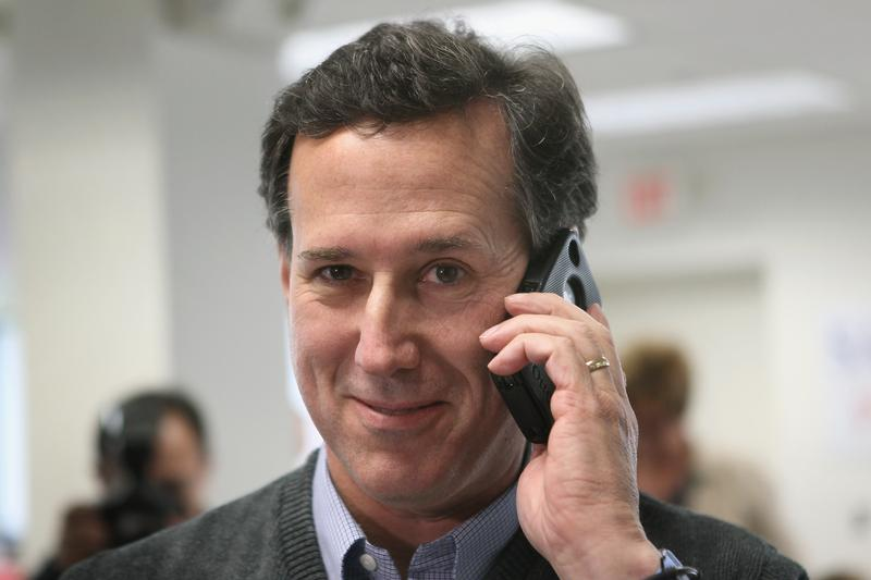 Republican presidential candidate, former U.S. Sen. Rick Santorum calls a voter looking for support during a visit to his campaign office on February 28, 2012 in Grand Rapids, Michigan.