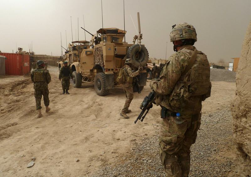 US soldiers keep watch at the entrance of a military base following the shooting of Afghan civilians allegedly committed by a rogue US soldier in Kandahar province on March 11, 2012.