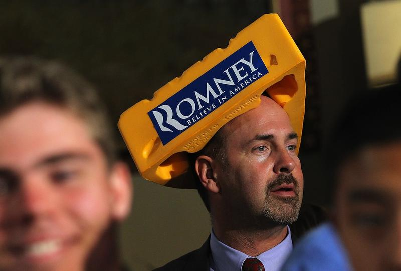 A supporter of Mitt Romney wears a Cheesehead hat during a primary night gathering in Milwaukee.
