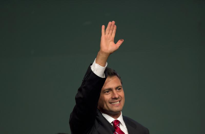Mexican President Enrique Peña Nieto celebrates after learning the first official results of his election.