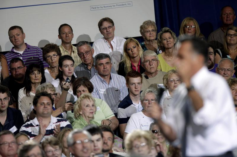 Ohio voters listen to Republican presidential candidate Mitt Romney at a town hall in Bowling Green, Ohio, on July 17, 2012.