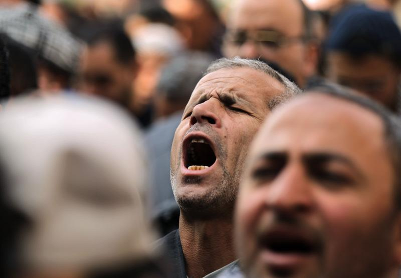 Egyptian anti-goverment demonstrators pray as they carry on with their protest in Cairo's landmark Tahrir Square on February 11, 2011, after the military threw its weight behind President Mubarak