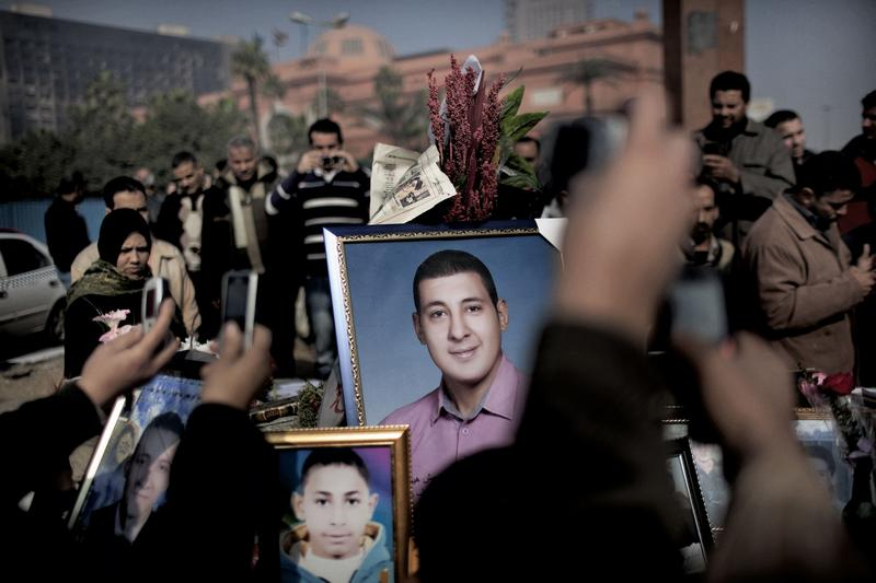 Egyptians gather in central Cairo's Tahrir square February 14, 2011 around portraits of those who perished during the uprising that toppled Hosni Mubarak
