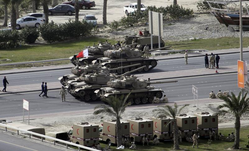 Bahraini army tanks take position near Pearl Square in Manama on February 17, 2011. Riot police stormed through the square firing rubber bullets and tear gas in a harsh crackdown.