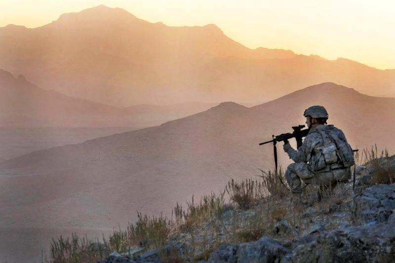 U.S. Army Spc. Jason Hebert provides security in the early dawn during an air assault mission above Tacome valley in Zabul province, Afghanistan, Oct. 14, 2009.