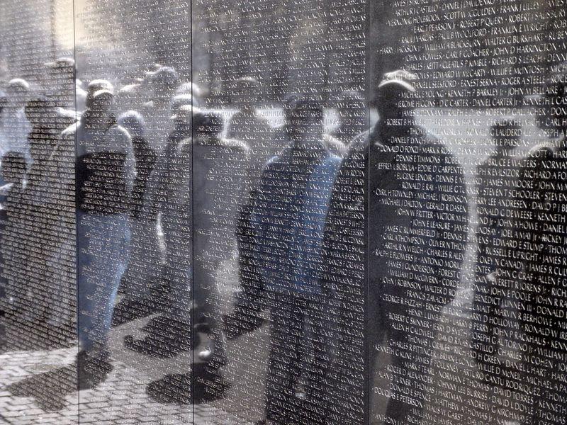 Veterans reflected in the Vietnam War Memorial