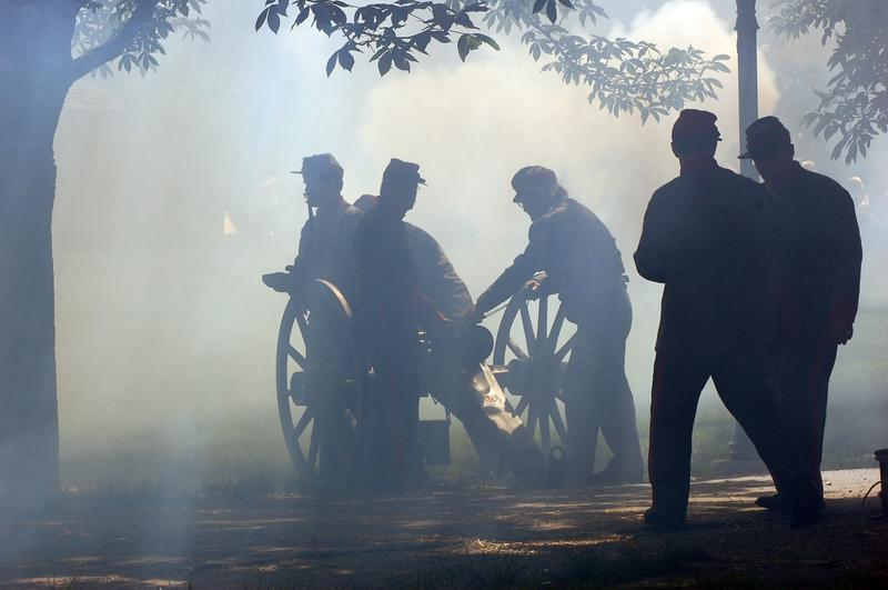 Smoke fills the air after several cannons were fired during a civil war reenactment in Naperville, Illinois