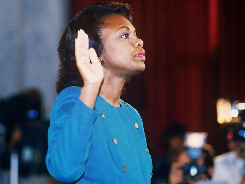 Anita Hill takes oath, 12 October 1991, before the Senate Judiciary Committee in Washington D.C.. Hill filed sexual harassment charges against US Supreme Court nominee Clarence Thomas.