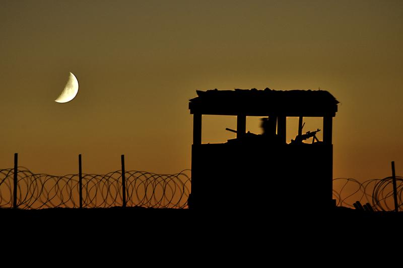 An Army soldier staffs a security outpost at a construction site approximately 25 miles north of Kandahar, in Afghanistan