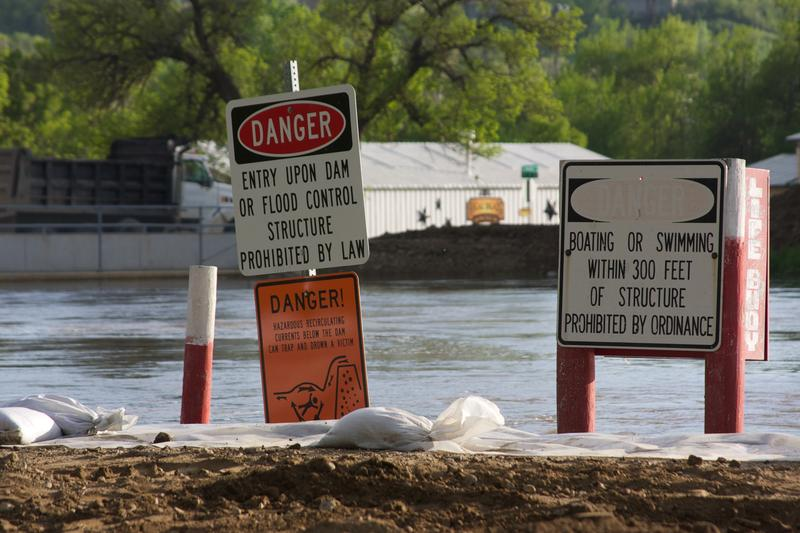 Flood warning signs near levees in Minot, North Dakota.