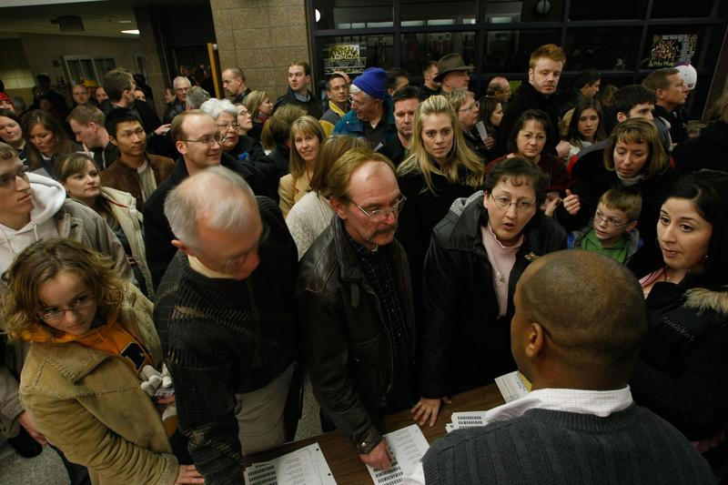 People register to caucus at Waukee High School January 3, 2008 in Waukee, Iowa.