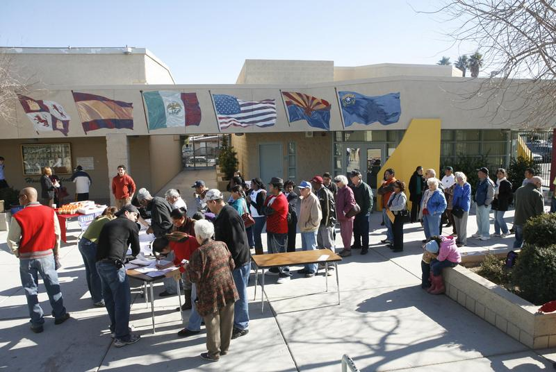 Voters line up to register at a caucus precinct in 2008 in a the largely Hispanic neighborhood in East Las Vegas, Nevada