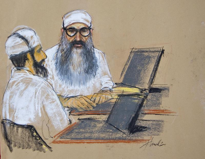 In this sketch by Janet Hamlin, Khalid Sheikh Mohammed and Waleed bin Attash attend their arraignment inside the war crimes courthouse at Camp Justice in Guantanamo Bay on June 5. 2008.