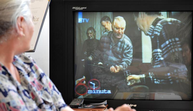 Bosnian Muslim woman, Munira Subasic, survivor of Srebrenica genocide in 1995, watches a video of warcrime fugitive, Ratko Mladic, broadcasted by Bosnian Television, in Sarajevo, on June 1