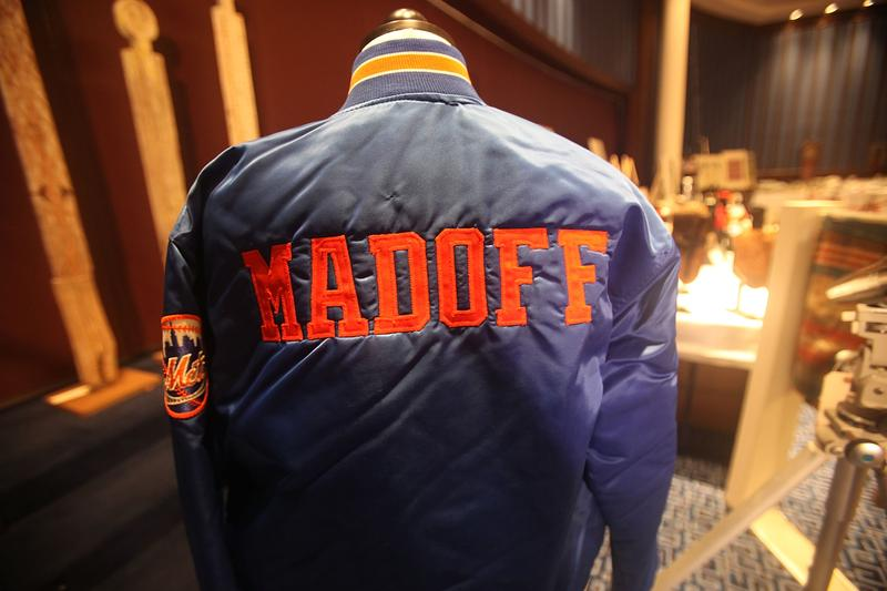 A Bernard Madoff New York Mets baseball jacket is displayed during a press preview of a U.S. Marhals Service auction of personal property seized from Bernard and Ruth Madoff.