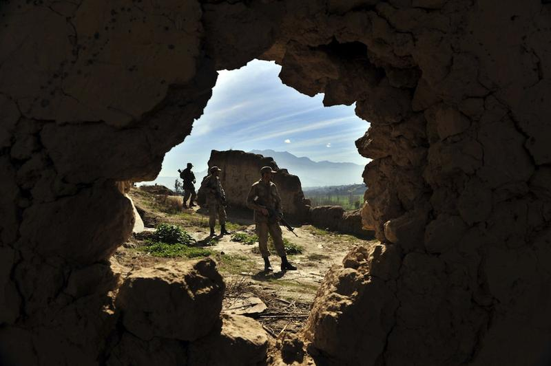 Pakistani soldiers stand guard outside a cave complex, a key militant headquarters in Damadola, in the Bajaur tribal region on March 2, 2010.
