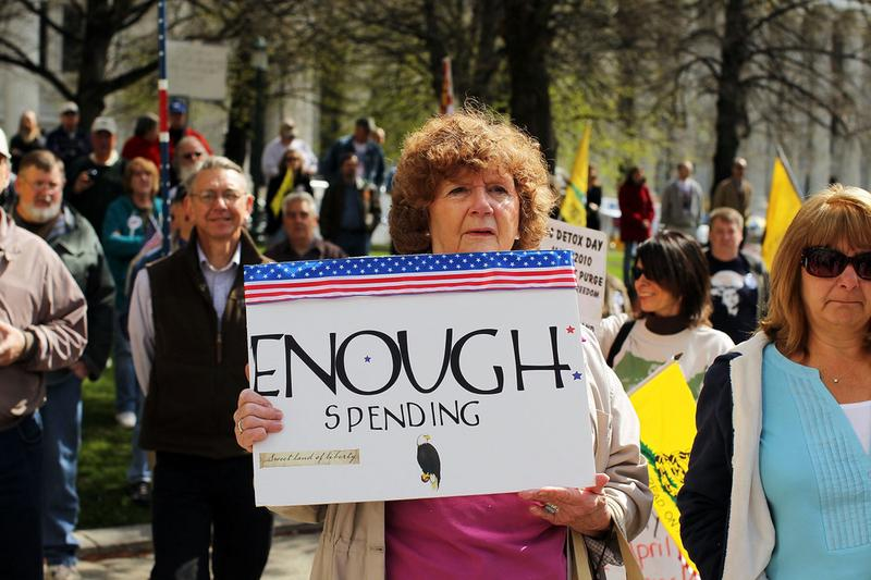 A participant at a Tea Party Express rally displays a sign critical of the Obama administration on April 13, 2010 in Albany, New York.