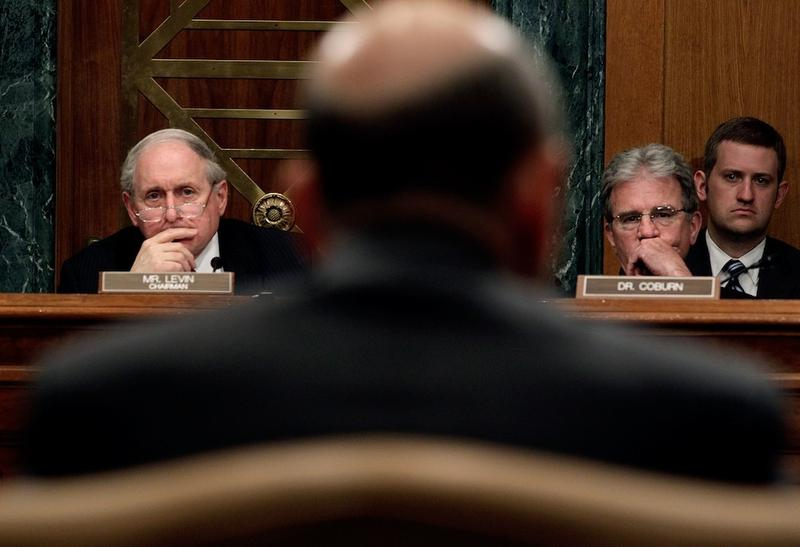 Committee Chair Sen. Carl Levin (D-MI) and ranking member Sen. Tom Coburn (R-OK) listen to testimony from Lloyd Blankfein, chairman and  CEO of The Goldman Sachs Group, on April 27, 2010