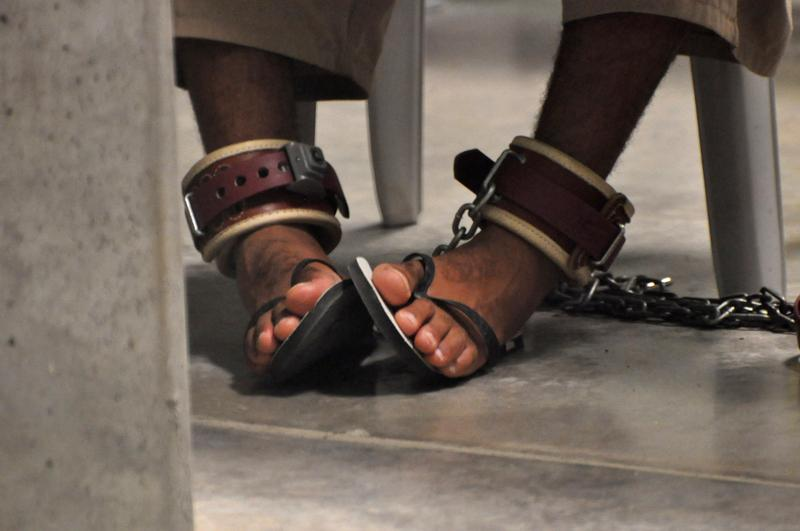 A Guantanamo detainee's feet are shackled to the floor as he attends a 'Life Skills' class.
