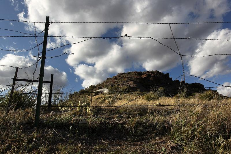 A barbed wire fence guards the U.S.-Mexico border on May 2, 2010 at Montezuma Pass, Arizona.