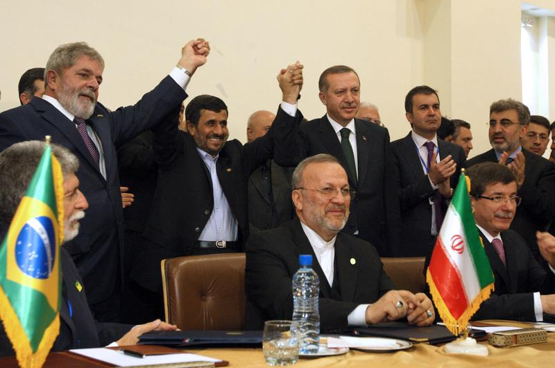 "Brazilian President ""Lula"" da Silva, Iran's President Mahmoud Ahmadinejad, Turkish PM Recep Tayyip Erdogan raise their hands together after signing a nuclear fuel swap deal in Tehran on May 17, 2010"