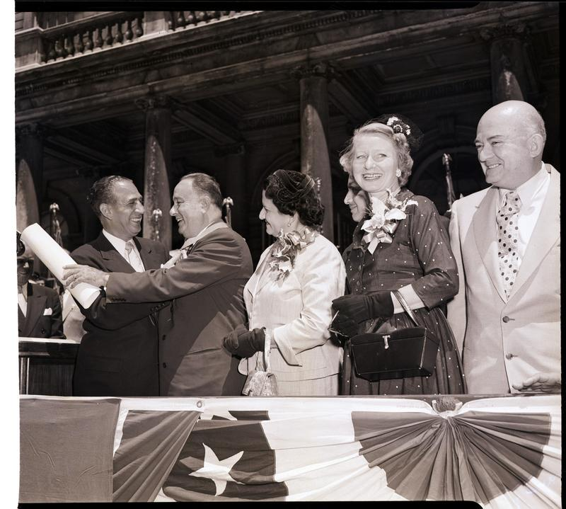 Mayor Impellitteri presents the city's medal of honor and a scroll for distinguished public service to the President of Nicaragua, Anastasio Somoza, at City Hall, June 20, 1952.