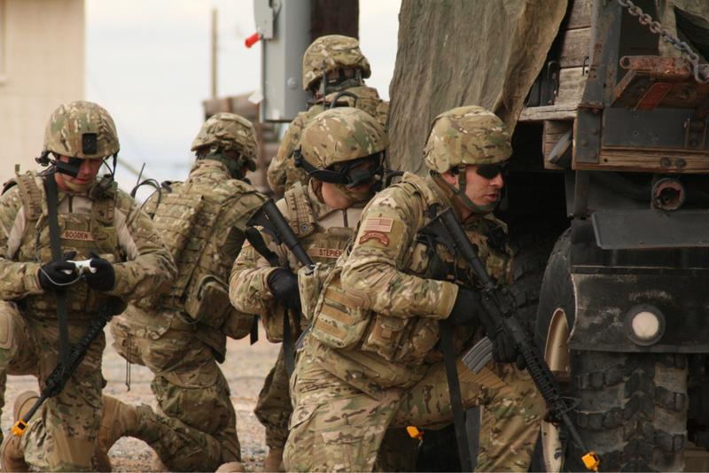 A Soldier (left) from the Future Combat Systems, Evaluation Brigade Combat Team, views his screen for unforeseen obstacles during an exercise and live demonstration.