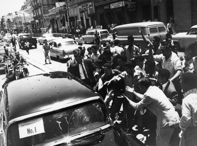 Rioters in Caracas, Venezuela attacking Richard Nixon's limousine, May 13, 1958.