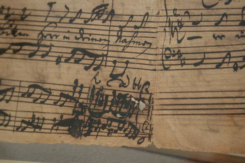The iron-gall ink Bach used to compose the cantata has eroded the paper.
