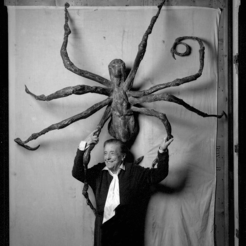 Artist Louise Bourgeois stands before her sculpture 'Spider IV,' in 1996.