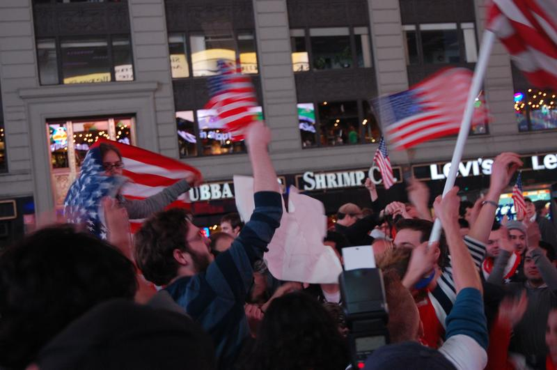 Celebrators cheer and wave American flags in Times Square at the news of Osama Bin Laden's death.